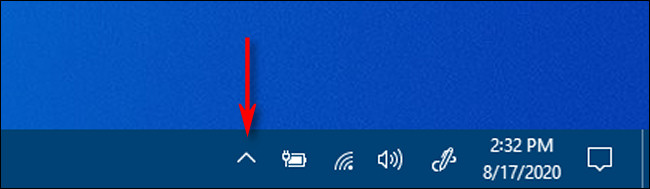 Cliquez sur la flèche en forme de carat dans la zone de notification de la barre des tâches pour voir les icônes cachées dans Windows 10.
